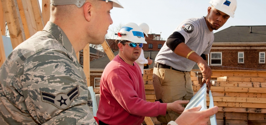 Military and national service members build homes together in Annapolis, Maryland. Source: Habitat for Humanity